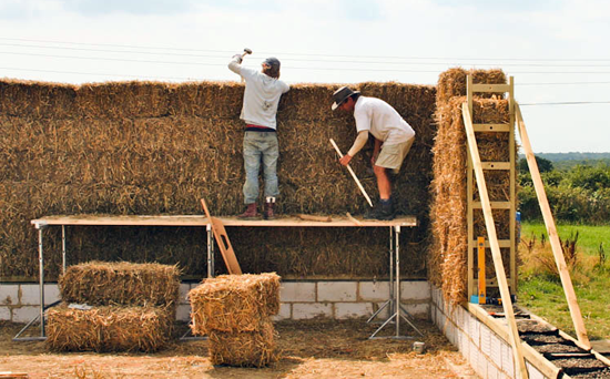 straw-bale-wall-going-up