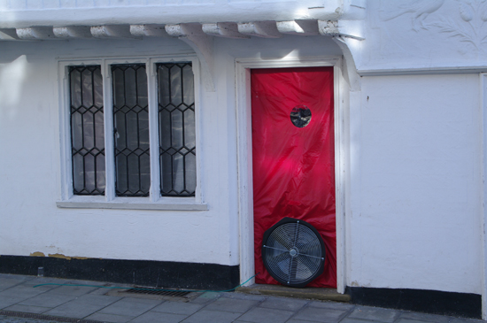 A blower door test being carried out