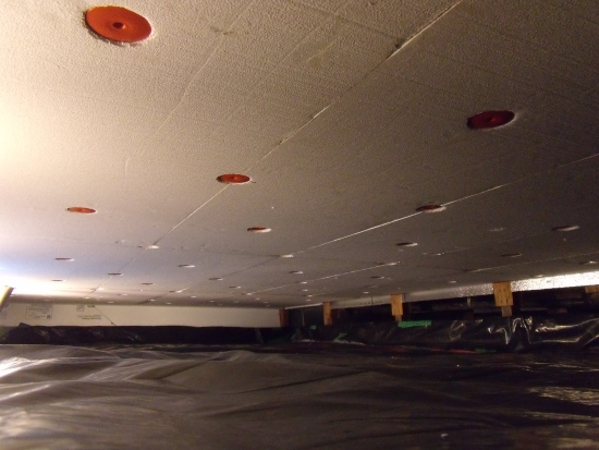 Two layers of clean black plastic separate the crawlspace from the soil and any moisture in the ground