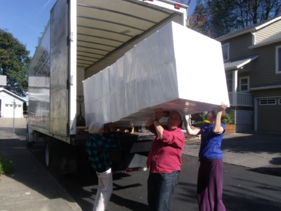 Tad's wife, sister and mother unloading a lorry load of Styrofoam