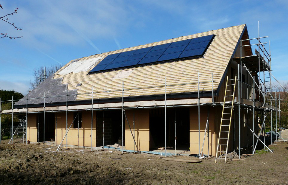 Solar-panels-and-tiles-go-on