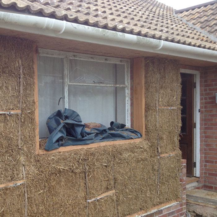 Hph078 externally insulating a bungalow with straw bales for Butler building house