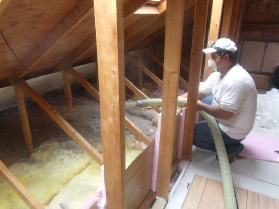 Cellulose being blown into the attic