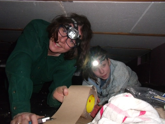 Wife Maria and eldest daughter Gwen helping in the crawl space