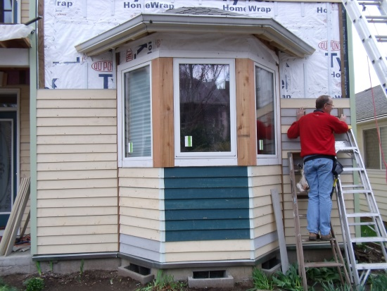 Replacing the salvaged wooden siding