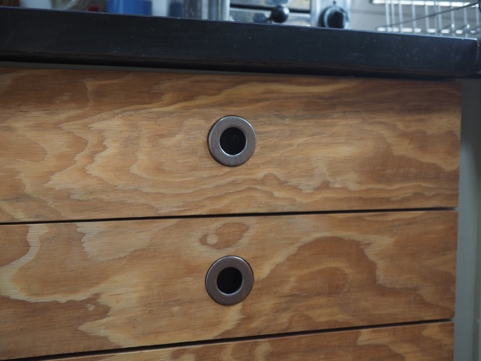 Example of VE interior detail - Kitchen cupboards made of shuttering ply and surplus stainless steel washers