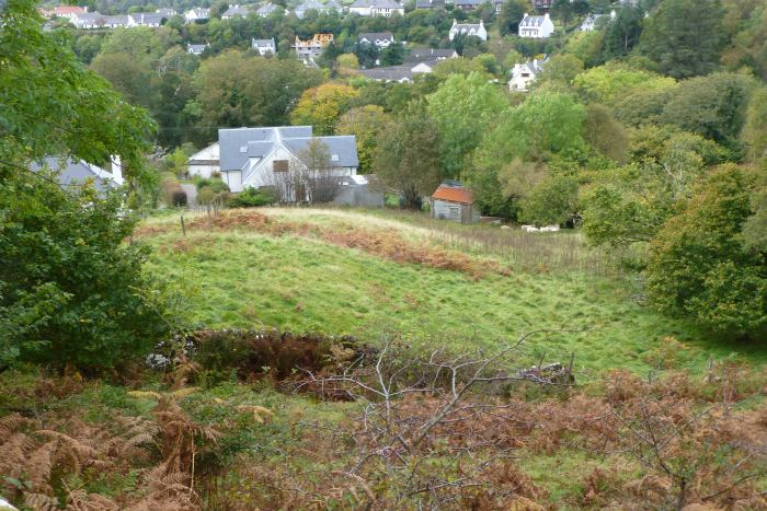 The site from above - on the left behind the trees is the roof of a 3 bedroom bungalow that was included in the package